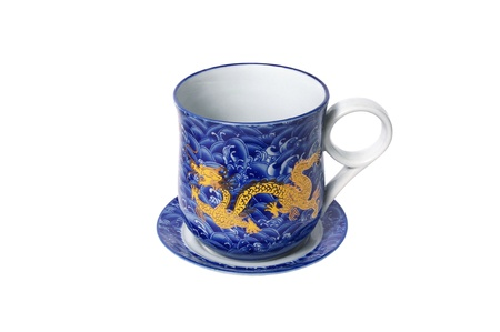 Porcelain saucer and cup  with a dragon pattern isolated on white background photo
