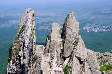 Rocks in mountains and town in valley Stock Photo - 13840736