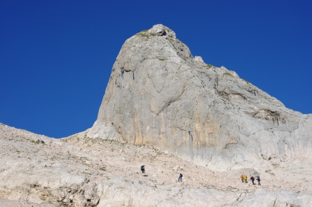 Group of climbers in the mountains among the rocks photo