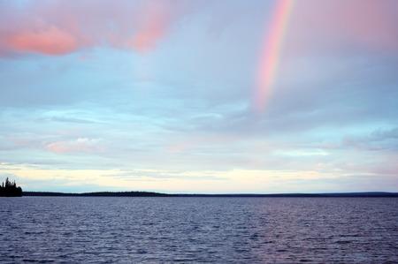 Rainbow in the sunset over lake Seydyavr behind the Arctic Circle on the Kola Peninsula