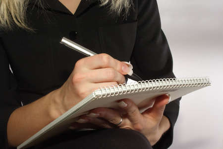 noting: Woman noting something on a piece of paper. See more of my Stock Photo