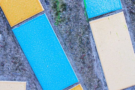 Large rectangular tiles of blue colors on the concrete surface Stock Photo