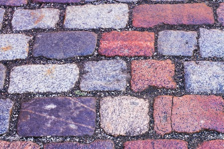 The old cobblestone texture of the Town Hall Square Stock Photo