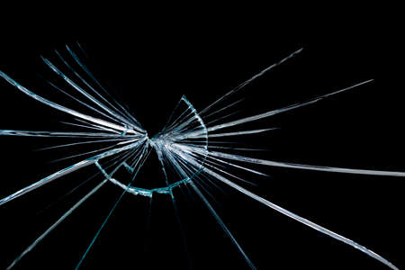 cracks on broken glass and mirror isolated on black background