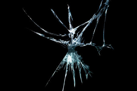 broken mirror glass on a black background in cracks in the form of an isolated image abstraction