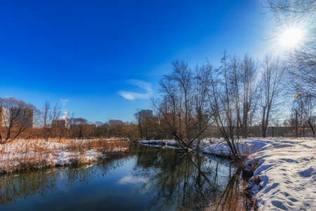 Winter Sunny day on the river. Frost and sun.