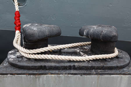 accent: mooring rope and a red accent Stock Photo