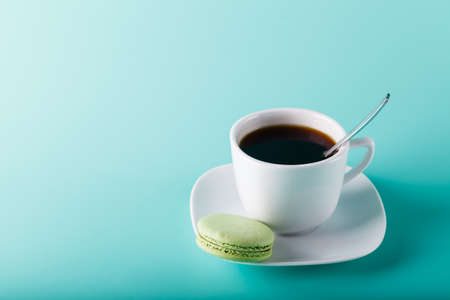 labelling: Coffee cup on aqua background with place for an inscription