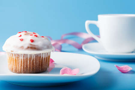 colorific: Colorful muffin on saucer with flower petal and ribbon