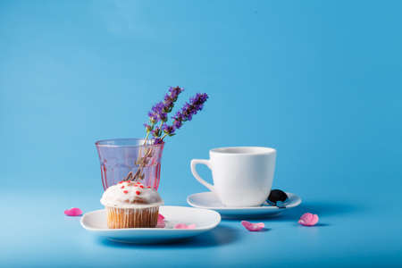 racy: Colorful muffin on saucer with flower petal
