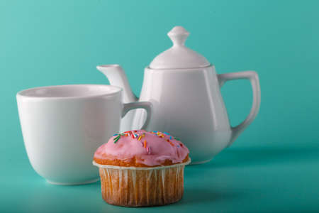 colorific: Colorful muffin with flower. Aqua color background Stock Photo