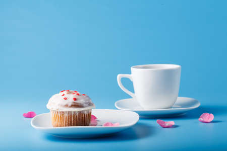 colorific: Colorful muffin on saucer with flower petal