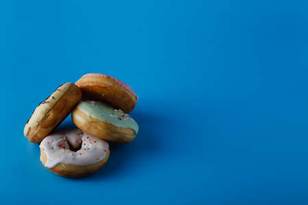 space for writing: Donuts on blue shadeless background with space for writing