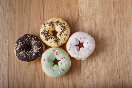 awry: Colored donuts on wood table