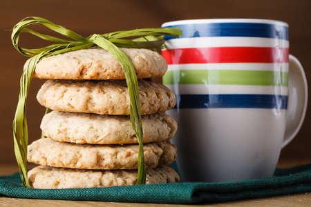 bounded: Bounded Oat cookies on wood table with milk Stock Photo