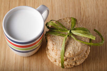 bounded: Bounded Oat cookies with milk on wood table Stock Photo