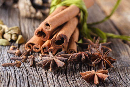 punch spice: Christmas or new year decoration. Spices for mulled wine on weathered wooden table
