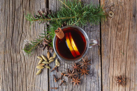 top of the year: Cristmass or New year concept. Mulled wine and spices on old wooden table. Selective focus