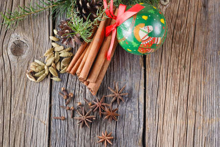 punch spice: Christmas decoration. Spices for mulled wine on rustic wooden table