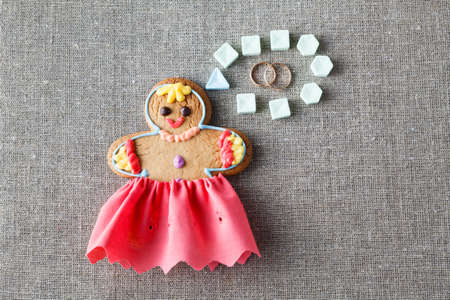 mariage: Mariage concept. Gingerbread girl with wedding dream Stock Photo