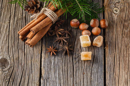 punch spice: christmas spices, chinnamon, anise on weathered wood. Mulled wine concept