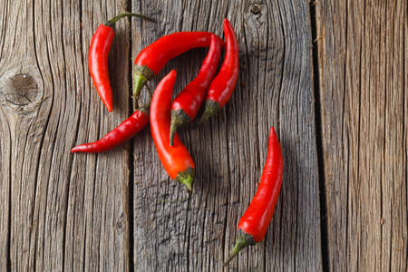 red chilli: Red chilli on rustic wooden table