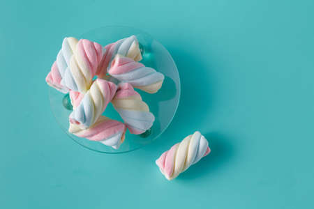 Twisted marshmallow on vibrant background, top view