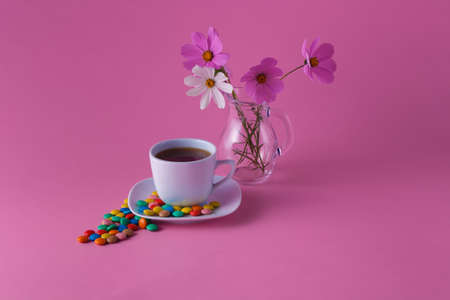 dragees: Morning tea cup with sweet dragees