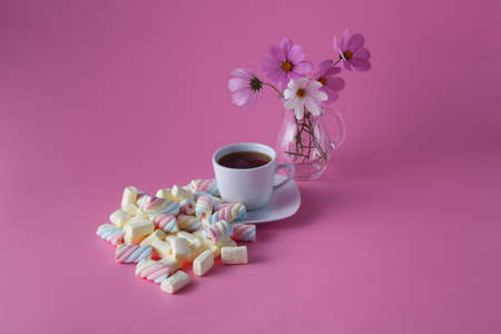 dropped: Morning tea cup with dropped marshmallow and flowers Stock Photo