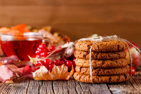 holiday food: Fall wealth on rustic wooden background with oat cookies