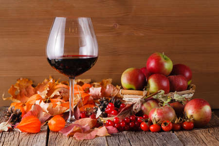 Fall wine with harvest on rustic wooden background Standard-Bild