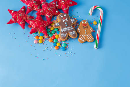 gingerbread man: Two gingerbread man on blue background with striped stick