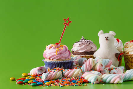 Many sweets with space for invitation, twisted marshmallow and cupcake