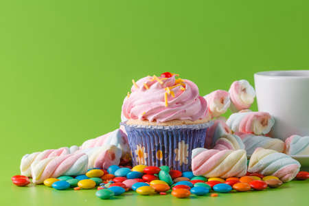 smal: Birthday smal gift. Sweet cupcake with candle Stock Photo