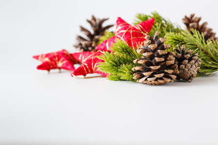 christmas tree ornaments: New Year and Christmas scene decoration with pine, cones and stars on white background