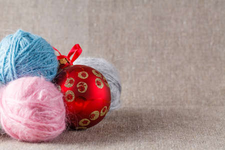 clew: Colored clew with red cristmass ball on cloth
