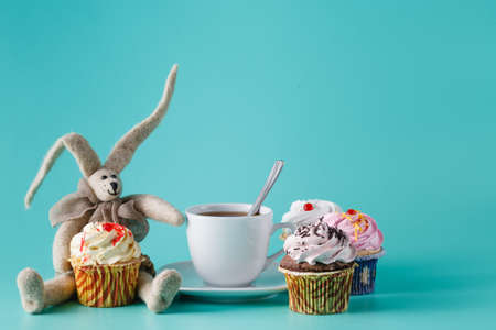 nostalgic: Nostalgic breakfast concept. Rabbit doll and cupcakes with cup of coffee Stock Photo