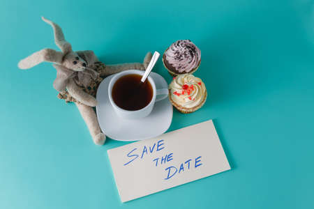 Cute rabbit doll with coffee and message save the date