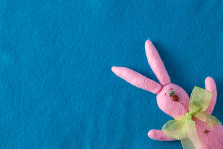 pink rabbit: Kid toy play concept. Frame with soft felt and handmade funny pink rabbit