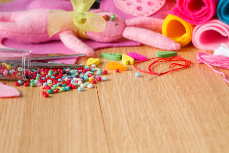 needlework: Female home hobby leisure concept. Needlework objects on table Stock Photo