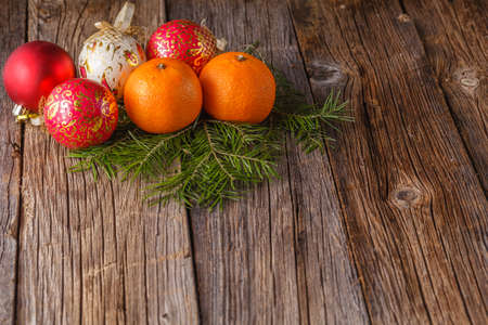 tabel: Christmas decoration idea. Balls with tangerines on rustic tabel Stock Photo