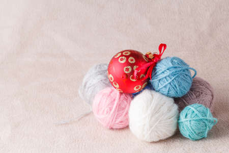 clew: Heap of wool clew on soft background with christmas decoration