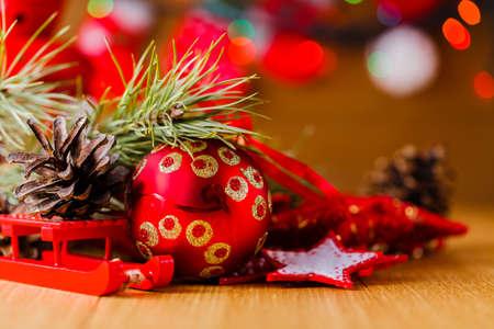 christmas lights display: New year decoration on table with Christmas tree garland
