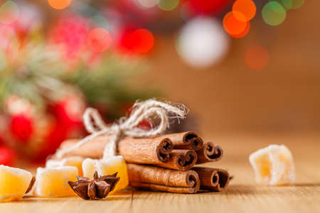christmas backdrop: New year decoration on table with cinnamon sticks