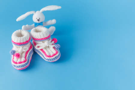 booties: Newborn announcement template. Handmade knitted booties  with toy