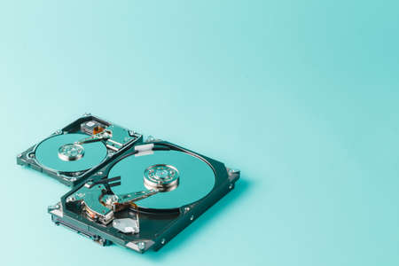 3 5: 3,5 and 2,5 hard disk drives opened on a blue background