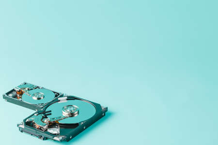 2 5: 3,5 and 2,5 hard disk drives opened on a blue background