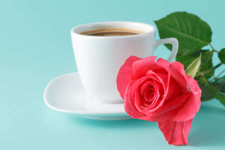 morning breakfast: cup of coffee on the table with rose flower, romantic morning breakfast