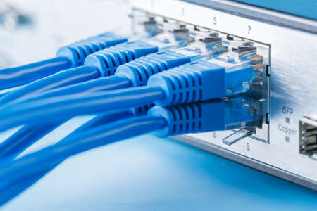 ethernet: Network switch and ethernet cables, small home network Stock Photo