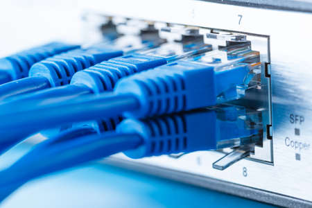Network switch and ethernet cables, small home network Stock Photo
